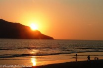 A family enjoying the late afternoon surf at Mazatlan