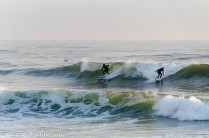 Early morning surfers enjoying their hobby.