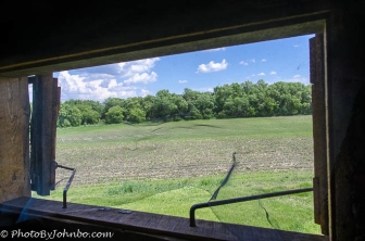 A view of the nearby forest from the rectangular framed port at Fort Abraham Lincoln in North Dakota.