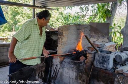 Huatulco blacksmith demonstrating his smithing skills.