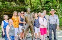 Part of our family gathered around a statue of Jack Daniel for a quick picture.