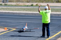 Marshalling an RC jet fighter.