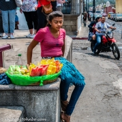 A bored fruit vendor
