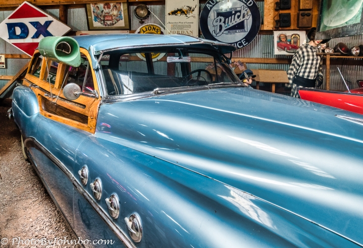 """1950s era Buick with """"window air conditioning""""."""